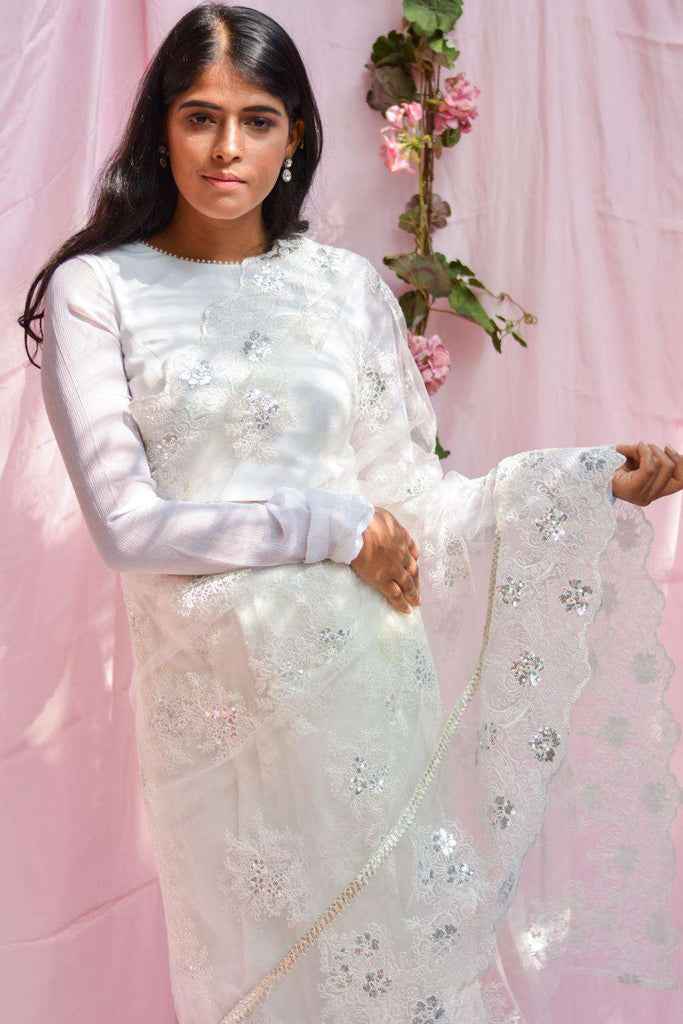 White net saree with lacy self-coloured threadwork and silver gota border - House of Blouse