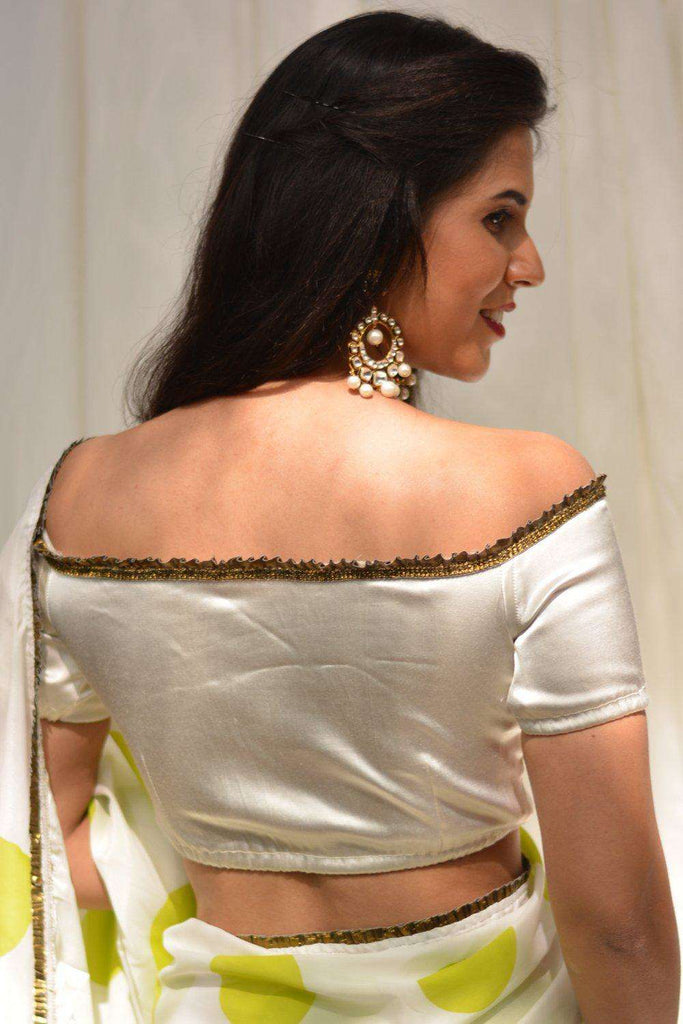 White stretch satin off-shoulder blouse with gold frill edging - House of Blouse