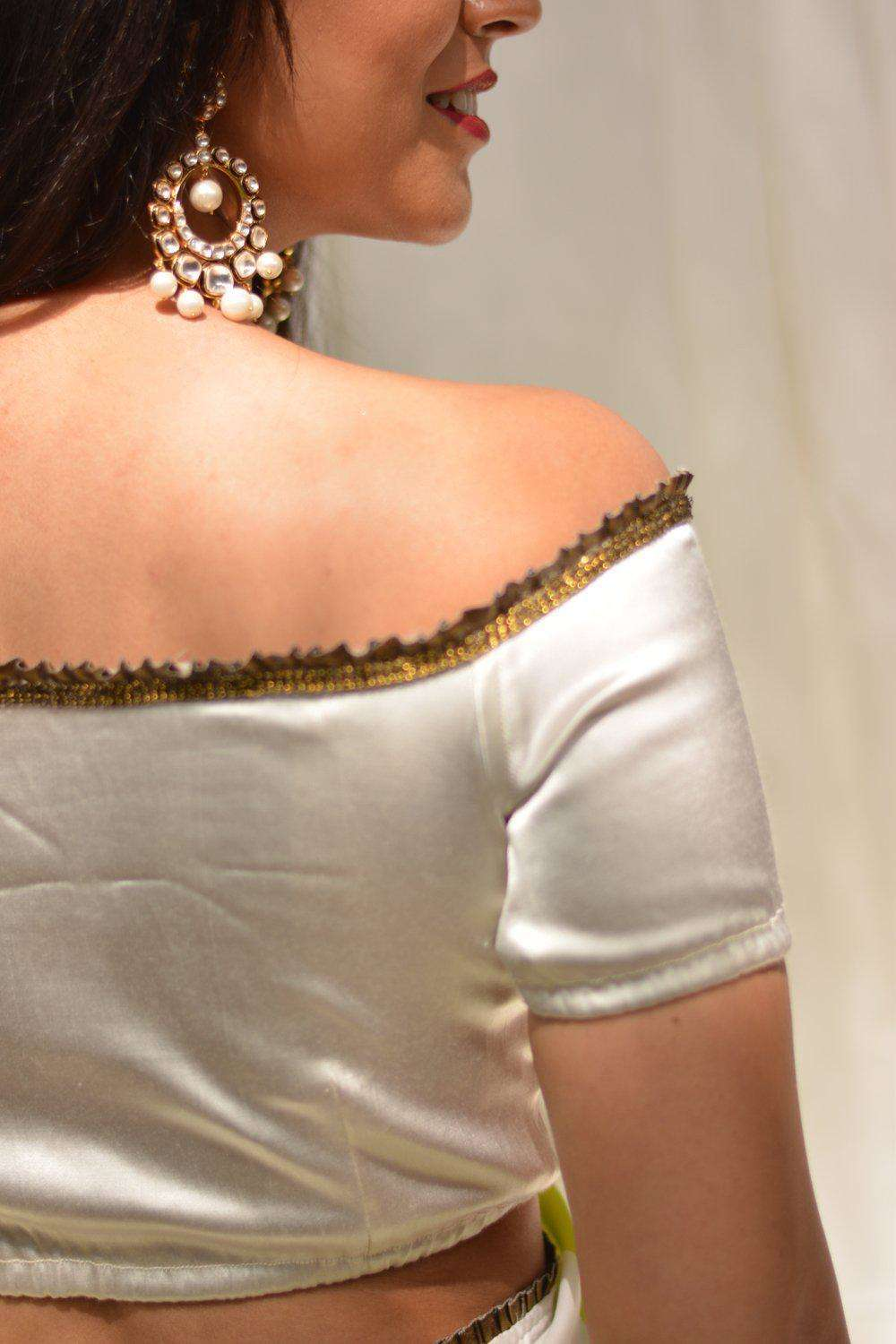White stretch satin off-shoulder blouse with gold frill edging
