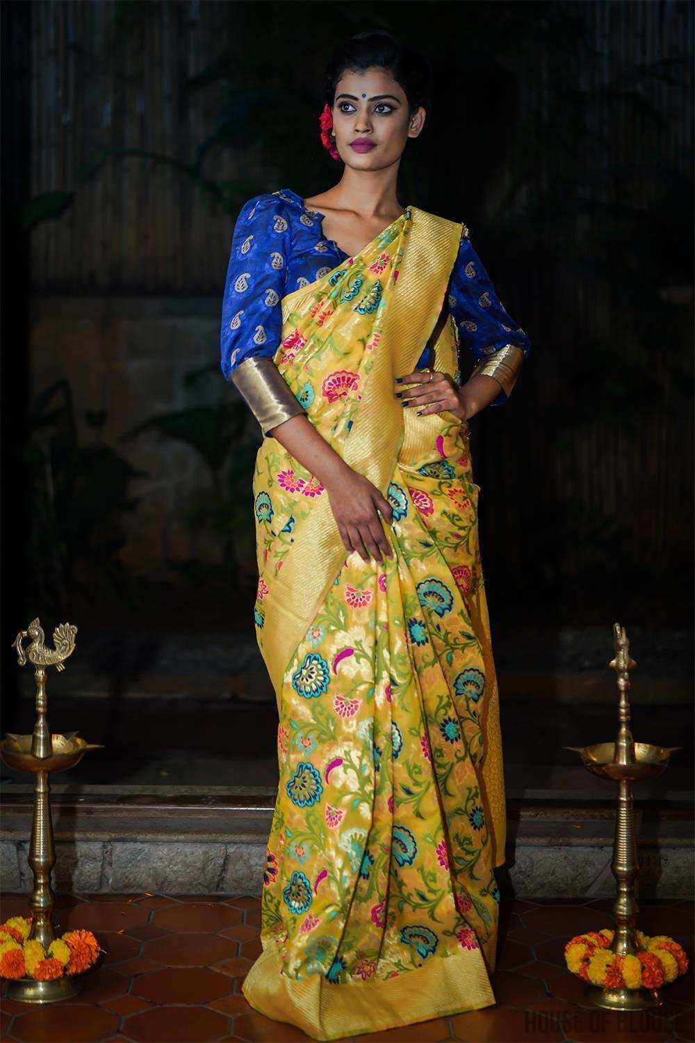 Yellow floral Banarasi tussar saree with zari border