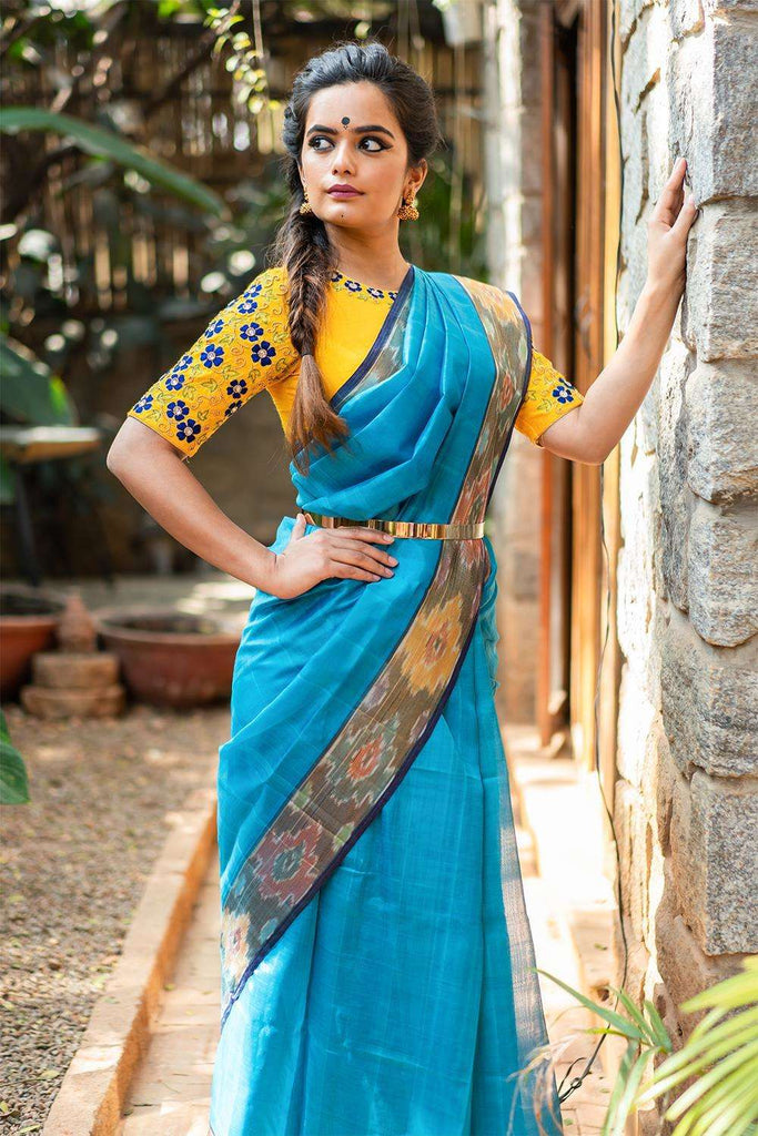 Zaara - Sky blue silk cotton saree with ikat border and dark blue edging