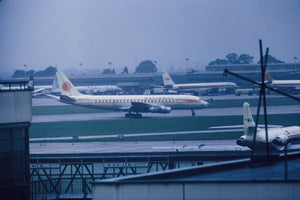 National Airways Douglas DC8 at a wet and dull Heathrow - ORIGINAL SLIDE