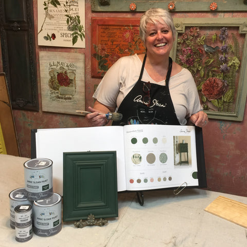 Not Too Shabby owner, Bobbi Eddy, poses with Chalk Paint® by Annie Sloan™ in Amsterdam Green