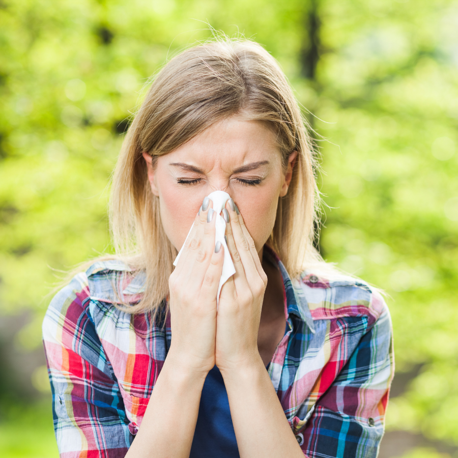 image of lady with a tissue after sneezing blog article on spring seasonal changes