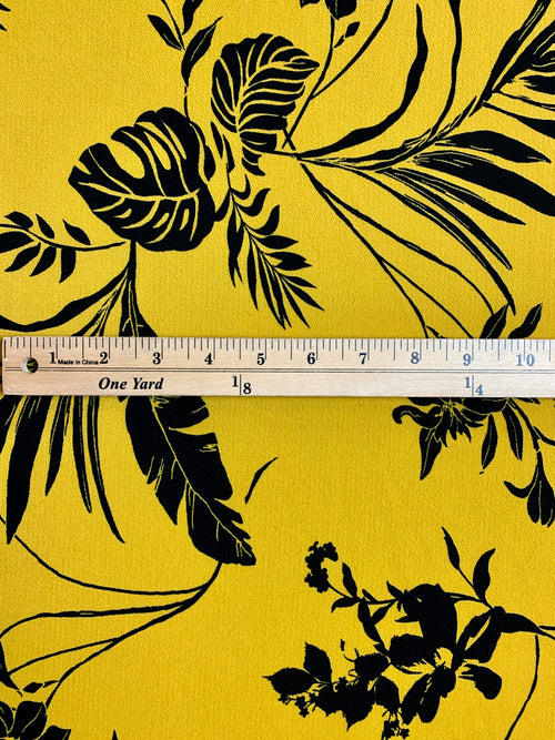 Bubble Crepe Fabric: Black Floral Print on Mustard