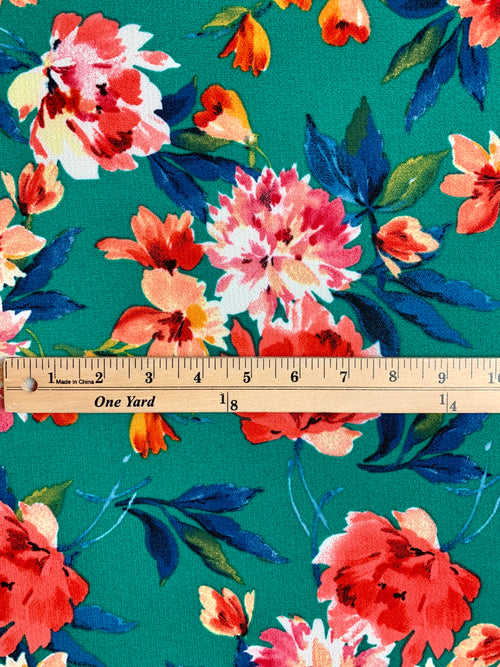 Bubble Crepe Fabric: Pink/Coral Flowers on Green