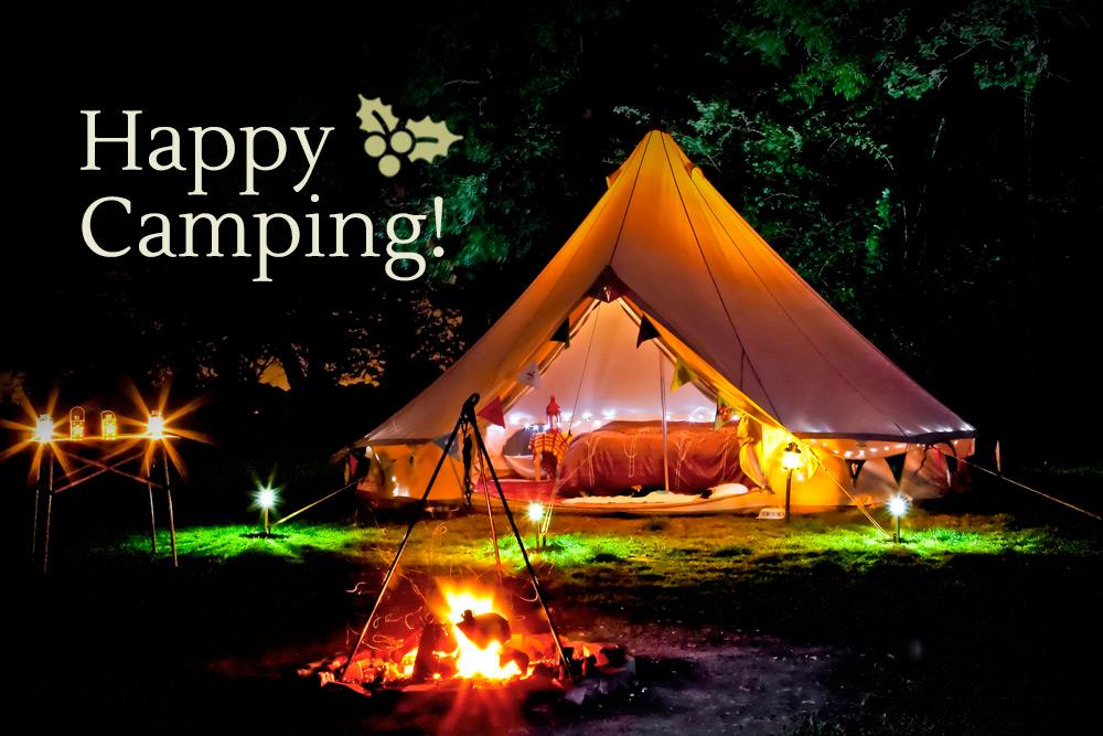 Bell tent and firepit in the night at christmas time
