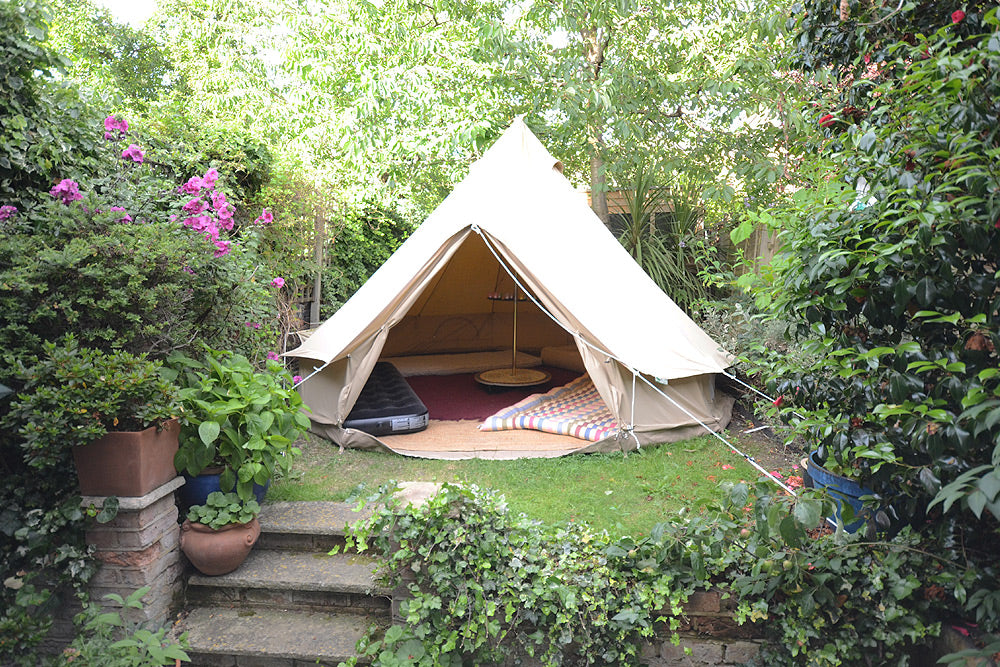 Bell tent in a postage stamp sized garden