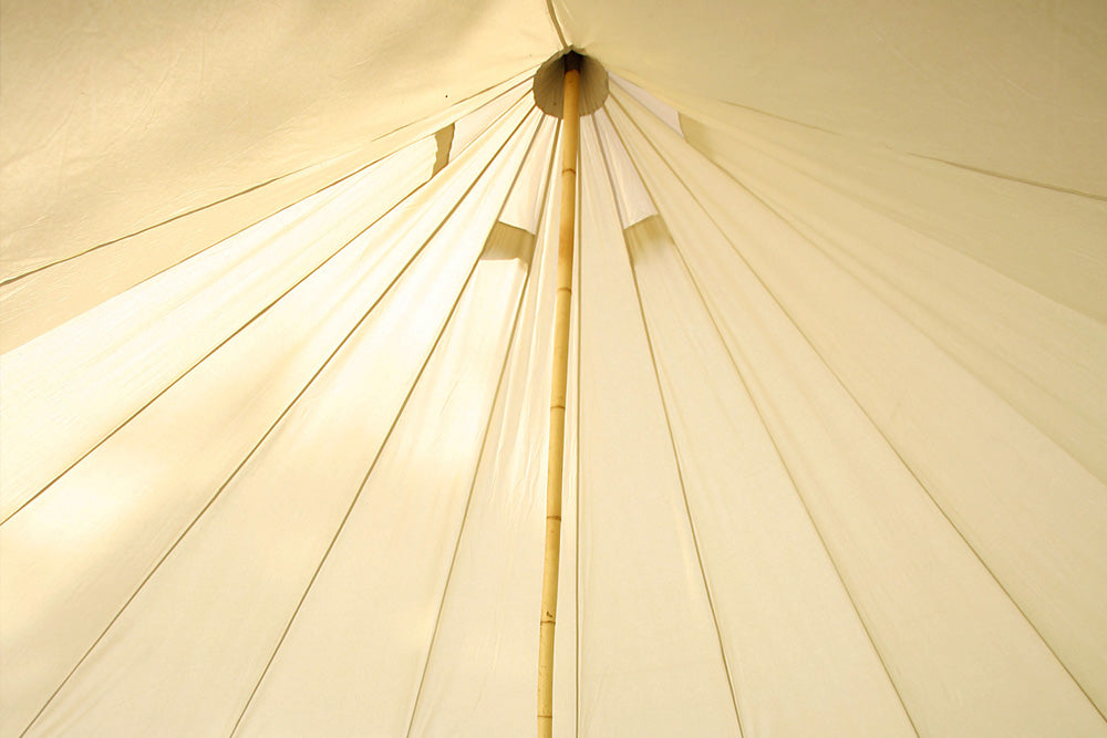 Interior of a bell tent with bamboo centre pole