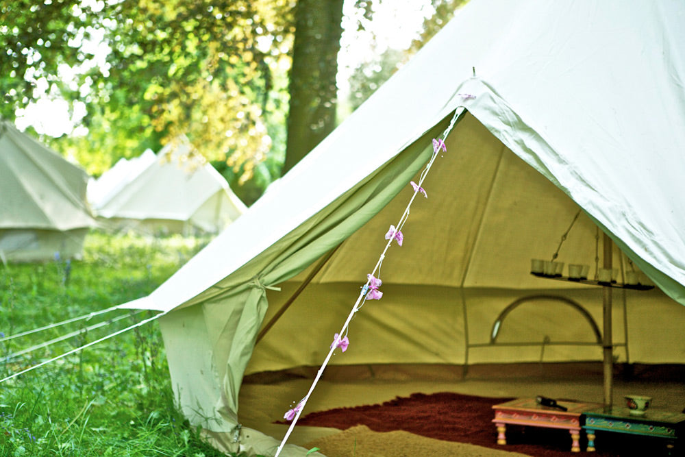 Cotton canvas bell tents in the woods