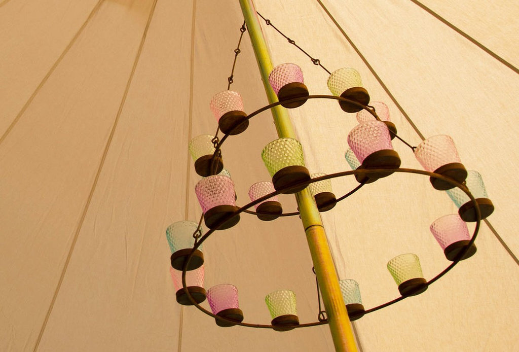 Double multi coloured glass tea light chandelier hanging from a bell tent centre pole