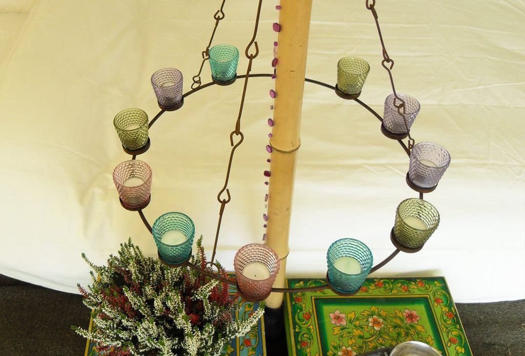 Single tier multi coloured glass tea light chandelier in a bell tent on a bamboocentre pole