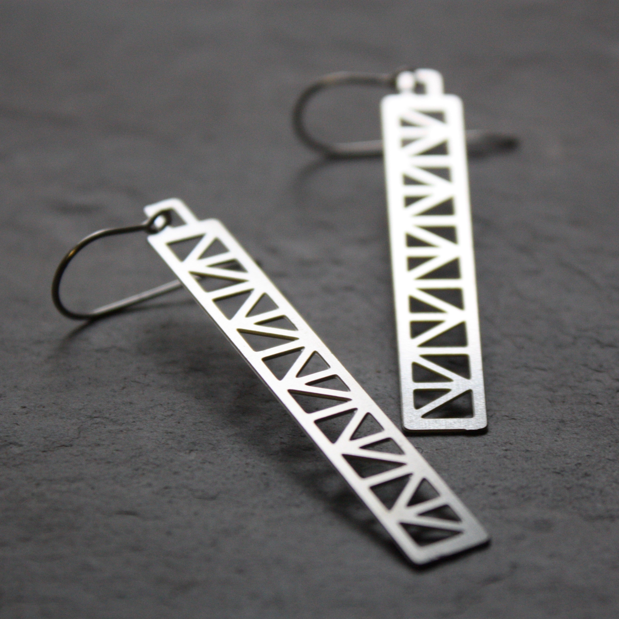 Peace Truss Earring design by Audra Azoury