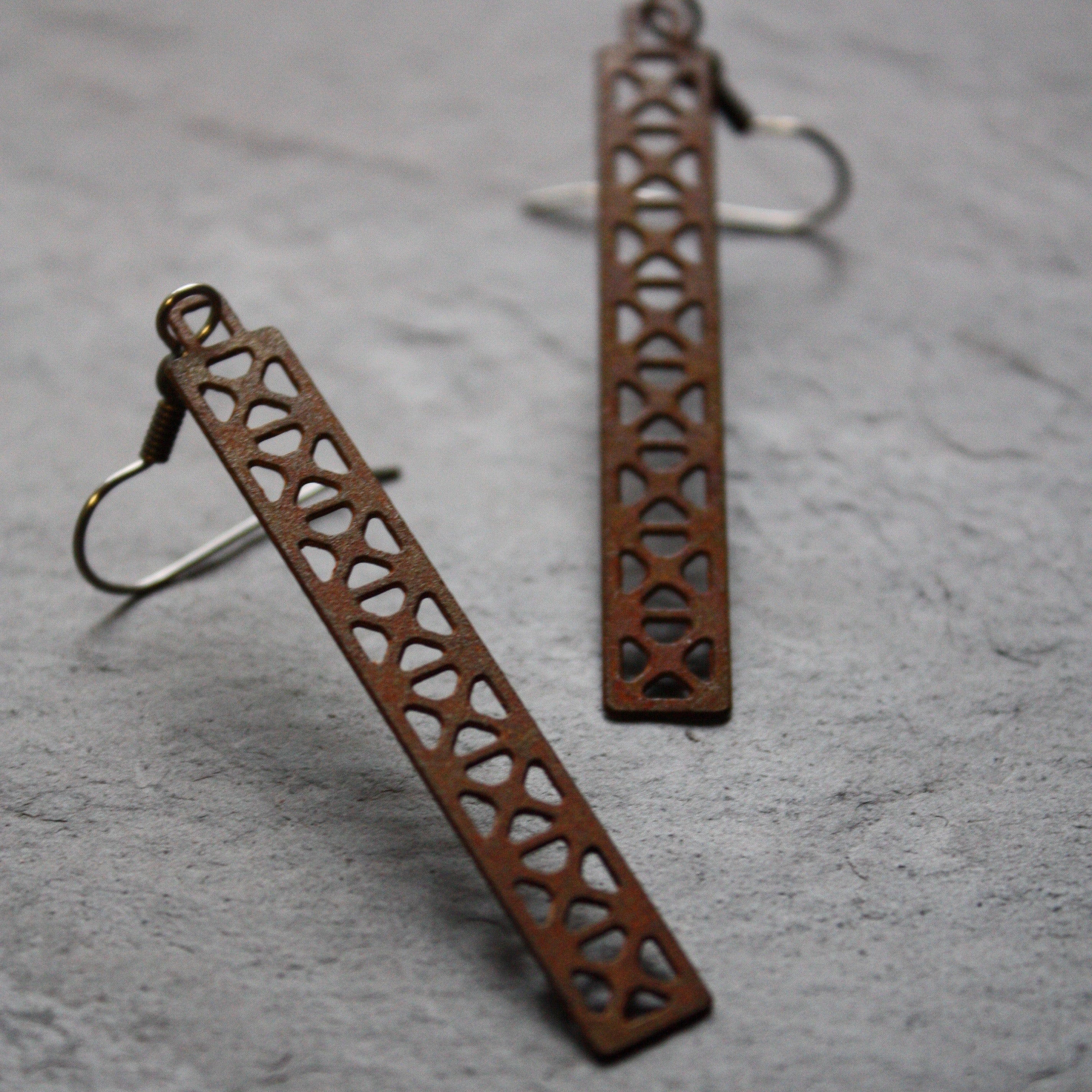 Bridge Earrings | X Truss Dangle in rust by Audra Azoury