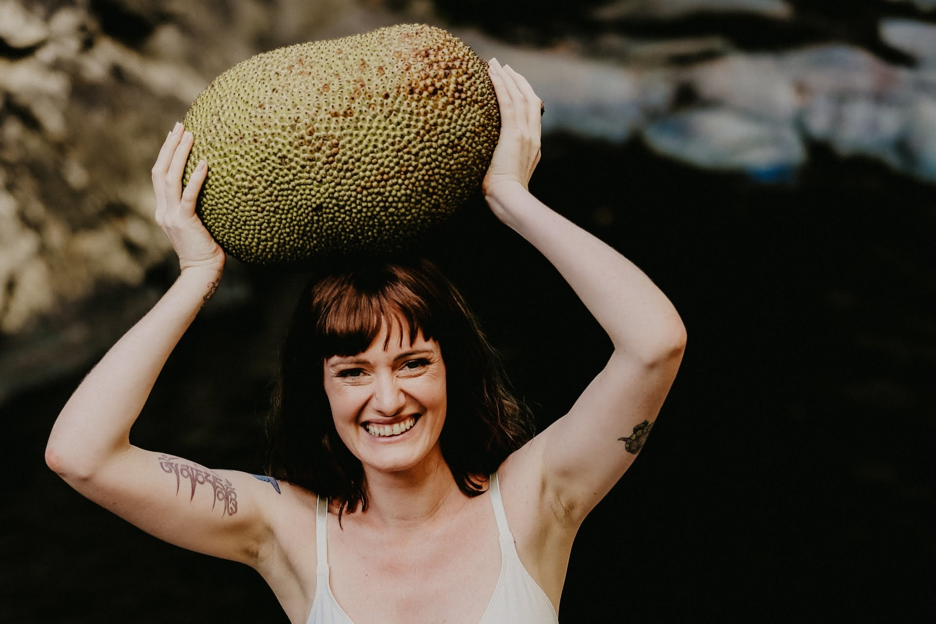 charada holding a jackfruit above her head
