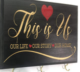 "7x9 Black""This is Us' Sign Home Decor Key Holder for Wall. Gift for couple. Wedding gift idea for couple. Bridal shower gift idea. Housewarming gift for couple."