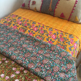 Tumeric and hot pink kantha single quilt. Shown here with lazy days in the garden and our floral gone wild quilts