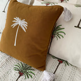 Smokey amber palm tree cushion with tassels
