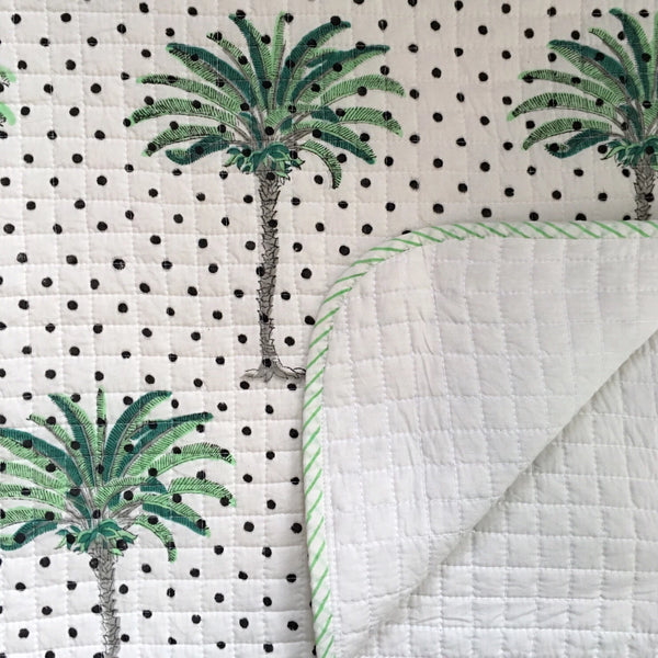 Polka dot palms on the cot