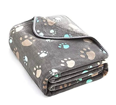 Soft puppy blankets will make your dog's ride home comfortable.