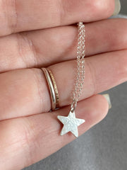 Sterling silver textured star necklace