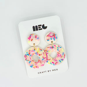 white vanilla donut drop clay earrings with rainbow sprinkles handmade