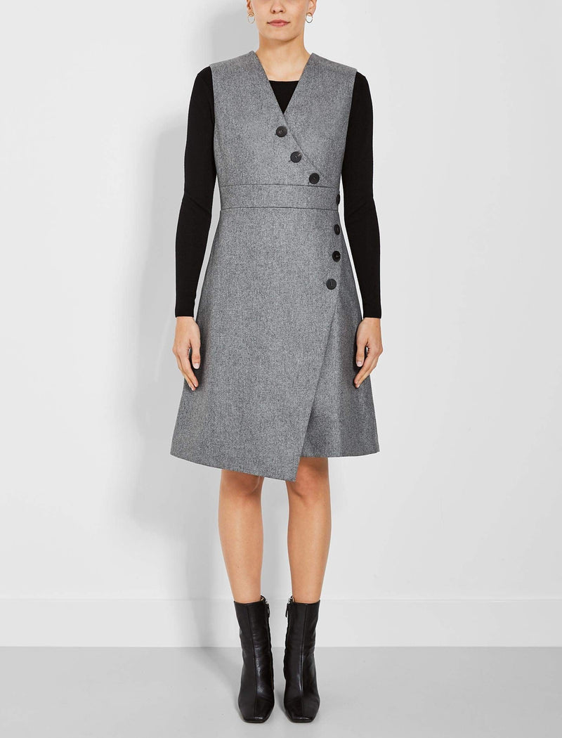 This sleeveless dress is a multi-seasonal dream that can be layered over shirts, tops or our slim-fit knits, or worn with nothing underneath – we've created a neat fit so there's no unwanted reveal and the dress is fully lined. The asymmetric style is super flattering with its gentle A-line and button details, which also add a chic touch. Team with boots – ankle length or knee-high – for an easy look that will take you through the day looking stylishly comfortable.