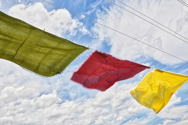 Image showing a washing line with three colorful tablecloths blowing in the wind