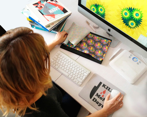 Grete working on modern home decor design at her Mac with Kill Mondays mousemat