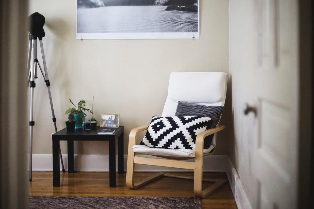Image of home interiors with a geometric cushion on a chair