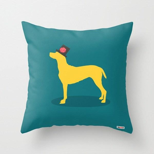 image showing teal coloured cushion with a print of a yellow dog