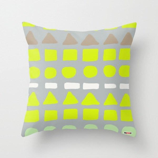 geometric cushion with lime green, gray and white colors