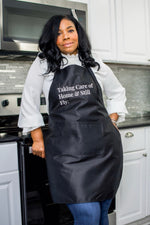 "Load image into Gallery viewer, ""Taking Care of Home"" Black Apron"