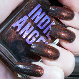 Fvck - deepest brown with orange flash superholo nail polish vegan
