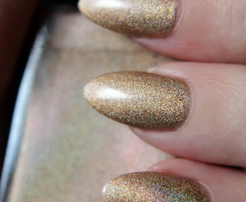 Nan - light gold holographic nail polish