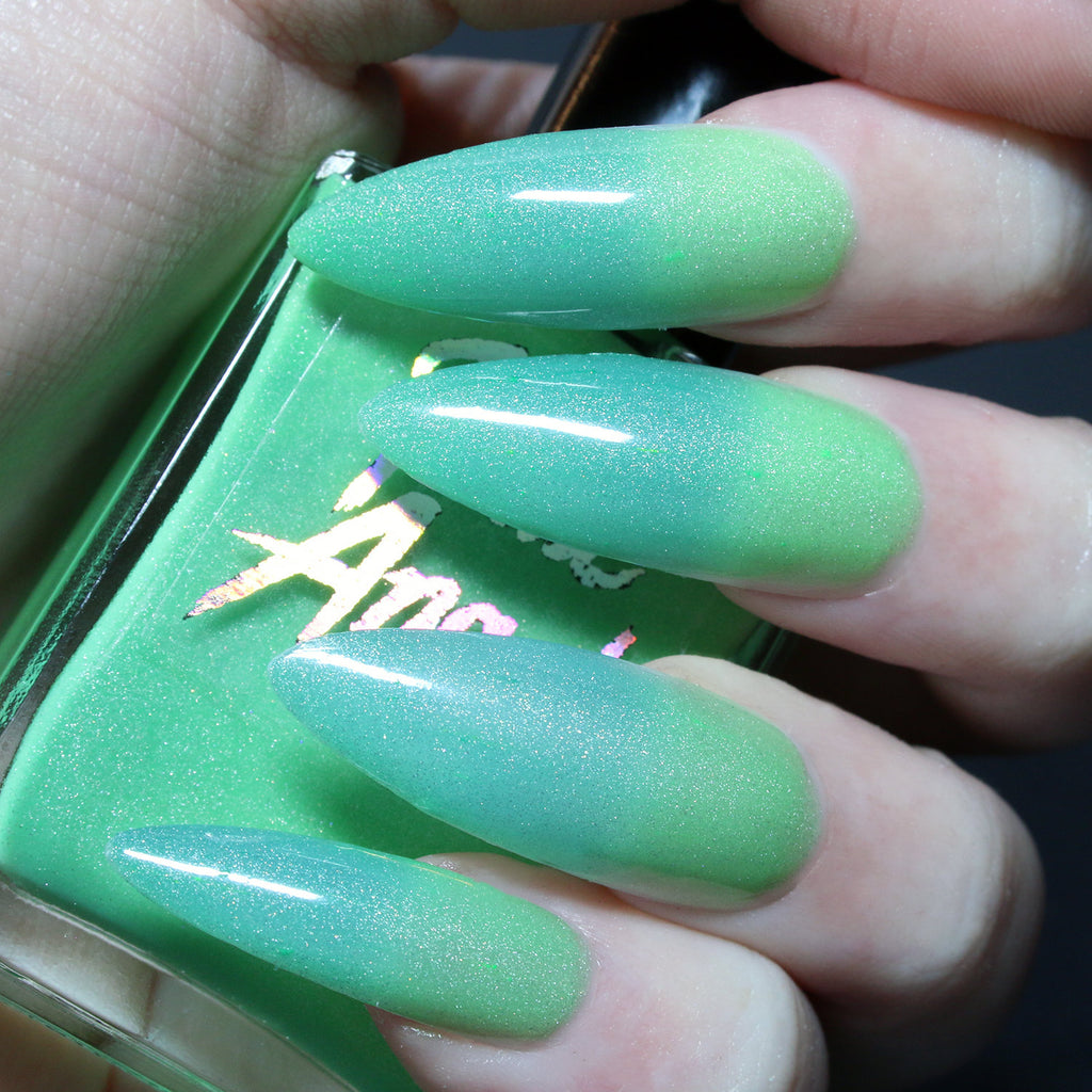 Sucker Punch - neon lime green to turquoise blue solar nail polish vegan
