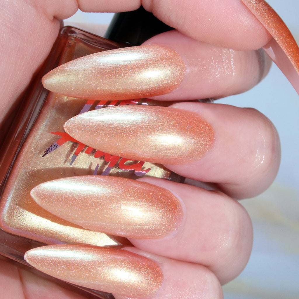 Main Squeeze - light orange gold shimmer nail polish vegan