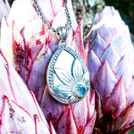 Mother of Pearl Pendant with Blue Topaz