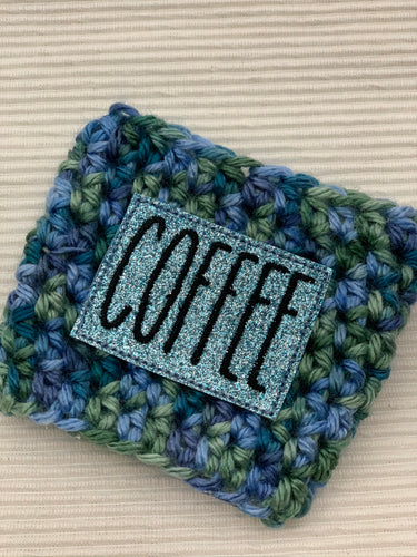 The Word COFFEE in Sparkle on Blue Multi Reusable Eco Friendly Hot and Cold Beverage Cup Cozy