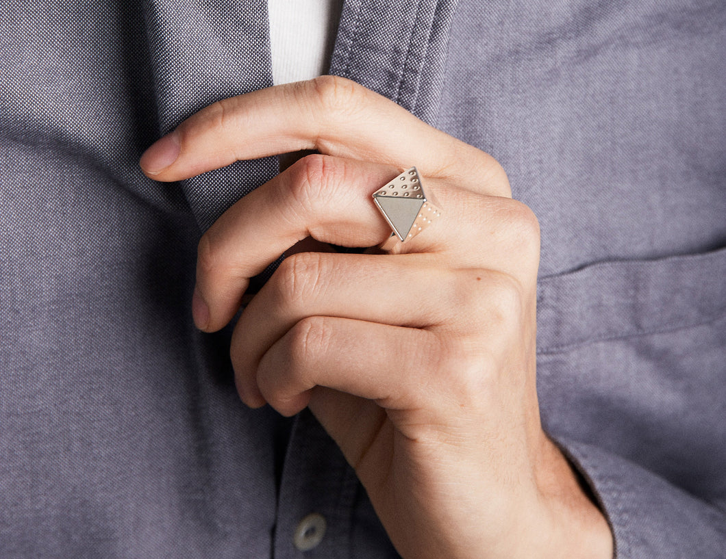 Close up of man wearing grey shirt and ring named 114 52