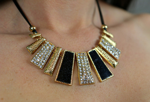 "Women's fashion bib necklace with metallic shimmer on a faux leather black 16"" band"