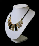 "Women's black and gold metallic fashion necklace on 16"" faux leather band"