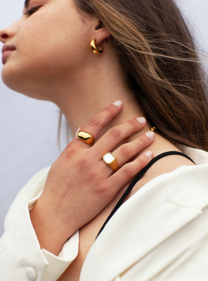 woman-wearing-Gold-chunky-stainless-steel-plating-statement-ring