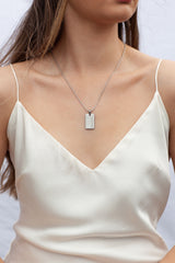 woman-wear-silver-breathe-pendant-stainless-steel-necklace