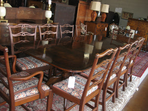Walnut dining room table with 10 chairs.