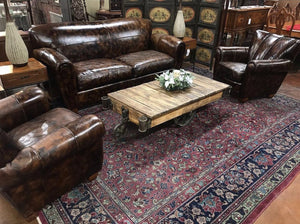 Brown leather sofa and chairs for the living room.