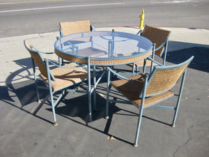 Outdoor round glass patio table with 4 chairs.