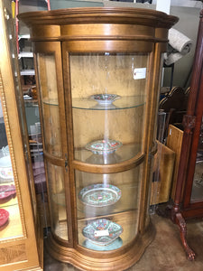 Bowed glass gilded curio cabinet