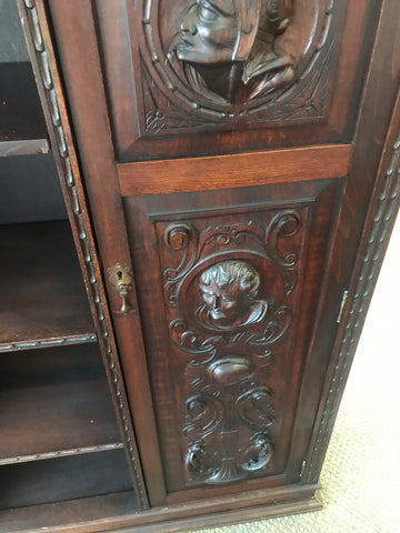 1900's heavily carved 2 door bookcase