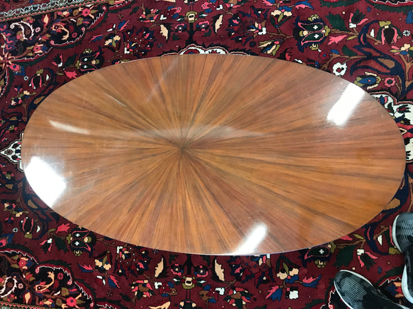 Mid-Century Modern oval coffee table with aluminum legs